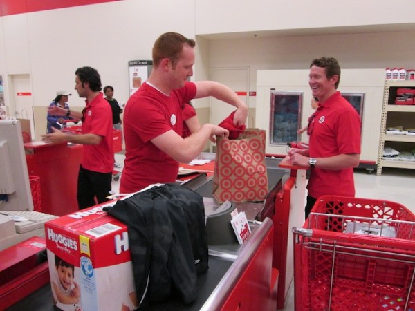 A Target team member helps Scott check out
