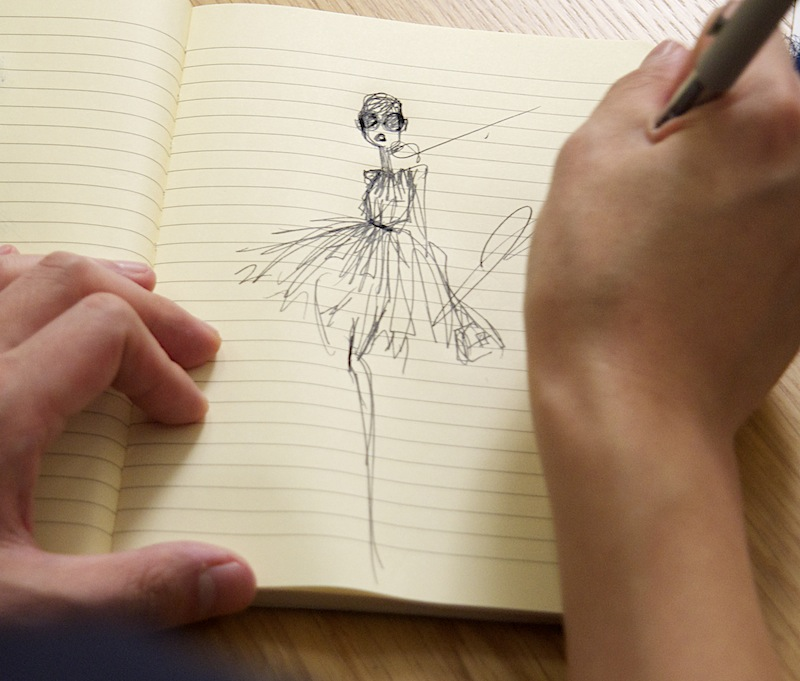The early stages of design -- Jason Wu sketches on his yellow legal pad