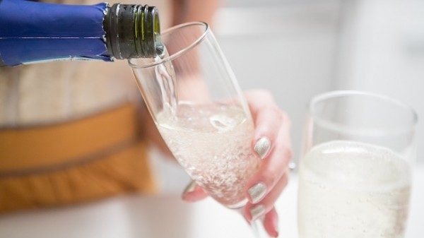 Pour the Prosecco and vodka into two Champagne flutes, dividing equally