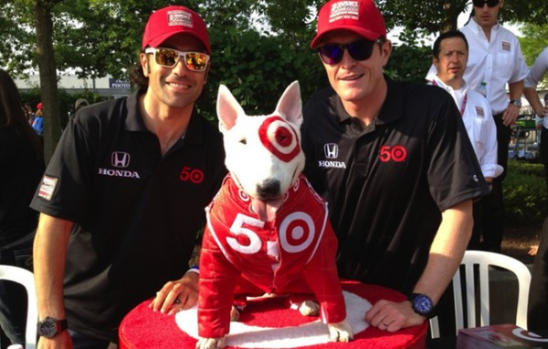 The dog days! Dario Franchitti, Bullseye and Scott Dixon get ready to sign autographs the day before